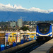 Canada Line Running Through Richmond and Vancouver City with Snow Capped Mountain Lions