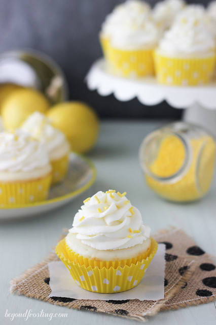 Luscious Lemon Cream Pie Cupcakes. Fluffy vanilla cupcake filled with a lemon mousse and topped with a tangy cream cheese whipped cream.