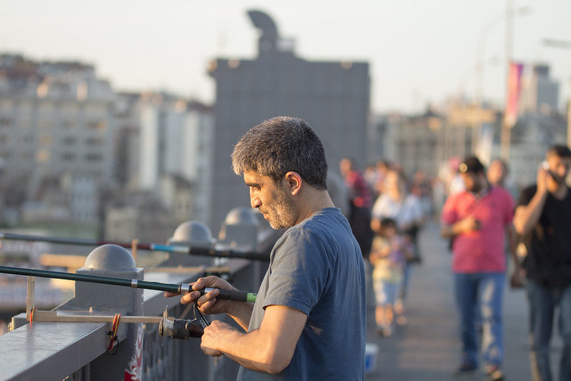 Man fishing from Galata Bridge