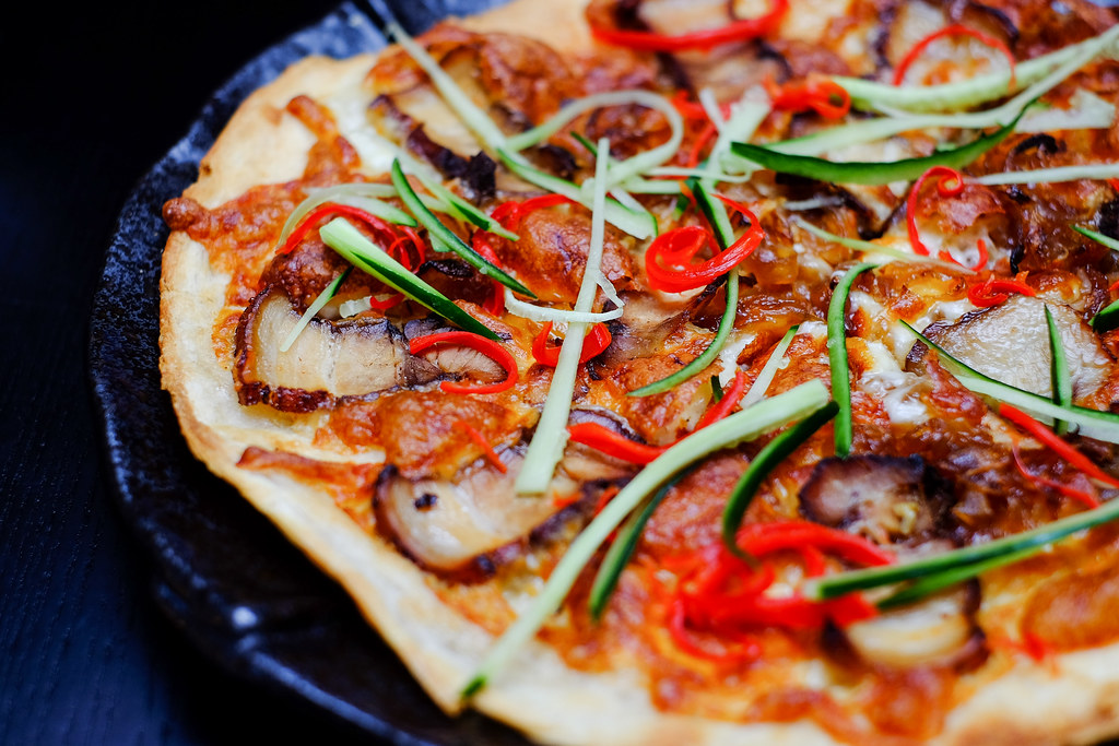 Monochrome Fusion Bistro's Juicy Pork Belly Pizza