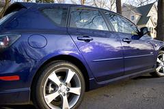 sedan(0.0), automobile(1.0), automotive exterior(1.0), executive car(1.0), family car(1.0), wheel(1.0), vehicle(1.0), mazda(1.0), rim(1.0), compact car(1.0), bumper(1.0), mazdaspeed3(1.0), land vehicle(1.0),