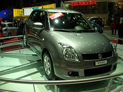 automobile(1.0), automotive exterior(1.0), supermini(1.0), vehicle(1.0), suzuki swift(1.0), auto show(1.0), mid-size car(1.0), city car(1.0), compact car(1.0), land vehicle(1.0), hatchback(1.0),
