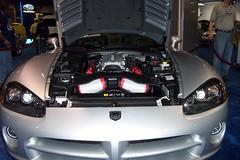 wheel(0.0), muscle car(0.0), automobile(1.0), automotive exterior(1.0), exhibition(1.0), vehicle(1.0), performance car(1.0), automotive design(1.0), auto show(1.0), land vehicle(1.0), luxury vehicle(1.0), srt viper(1.0),
