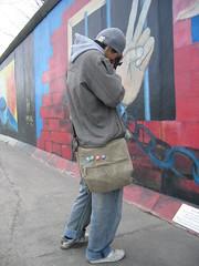 street artist(0.0), art(1.0), wall(1.0), street art(1.0), road(1.0), mural(1.0), graffiti(1.0), street(1.0),