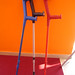 Crutches against orange wall