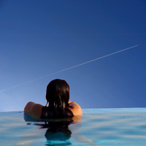 woman at rest - minimal streaking the blue sky