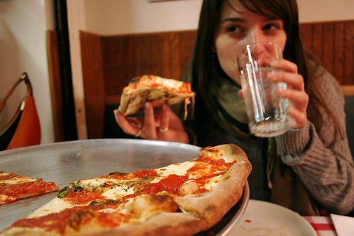 girl eating vegan pizza in Las Vegas