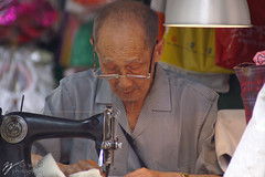 Elderly Hong Kong Man At Work