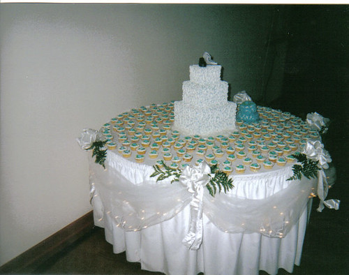 Wedding cake table with mini cupcakes and accent cake