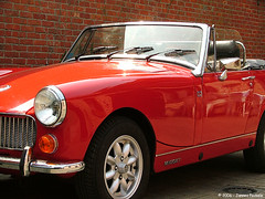 datsun roadster(0.0), austin-healey sprite(0.0), sports car(0.0), automobile(1.0), vehicle(1.0), mg midget(1.0), antique car(1.0), classic car(1.0), vintage car(1.0), land vehicle(1.0), convertible(1.0),