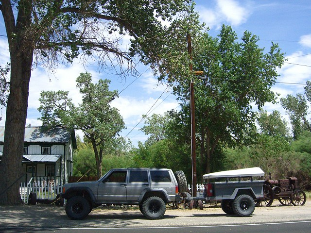 Off road rig with crank up tent and trailer