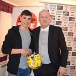 Glenn Murison presents Match Ball Sponsor Kevin Stuart with a signed ball