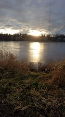 Sun low in thr sky over Westchester Lagoon, Anchorage