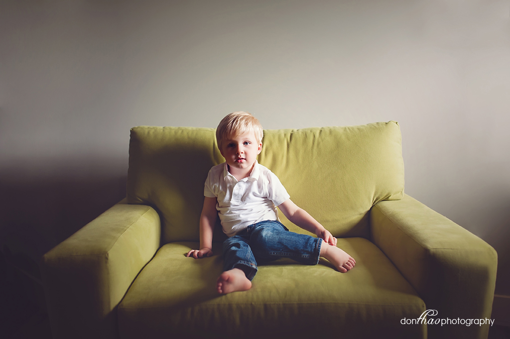 Brothers on Green Chair in Michigan newborn photographer