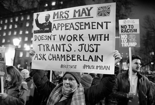 Mrs May - appeasement doesn't work with tyrants.  Demonstrator at the anti-trump protest in central London.