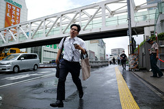 A morning in Shinjuku, salaryman on the go.