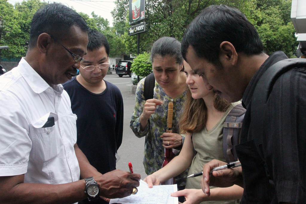 Indonesian local government official helping M.R.P. students, associate professor Victoria Beard, and Fuad Jamil (Indonesian NGO collaborator) from Yayasan Kota Kita map a case study of informal urban settlement in Surakarta, Indonesia.