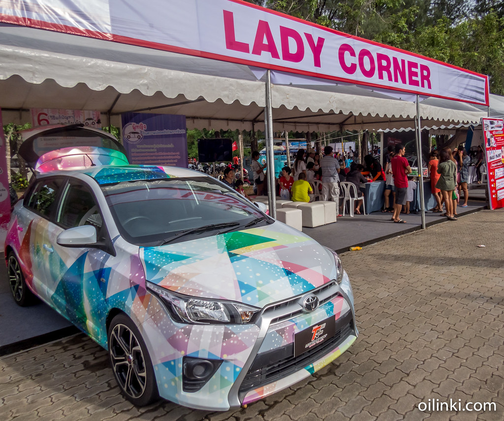 The lady corner and pastel colored car.Phuket, Thailand