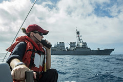 Lt. Hannah Bennett communicates with USS Preble (DDG 88) while conducting boat operations in the South China Sea, June 11. (U.S. Navy/MC3 Alonzo M. Archer)