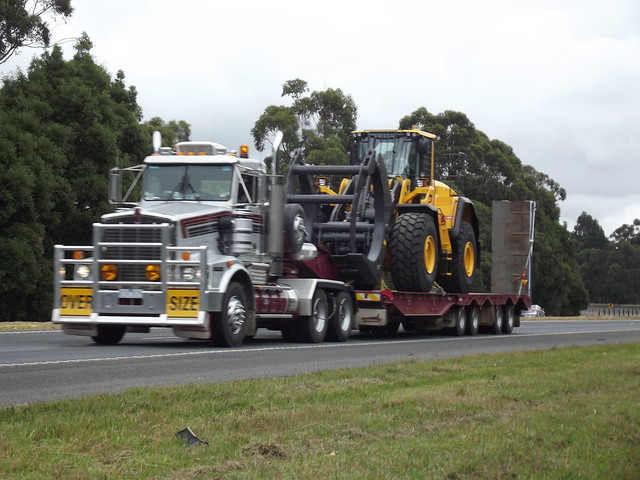 Patlin Transport Kenworth T658, with Wide, Heavy Load, a Volvo front loader, at Moe, Vic, Aust, 2012