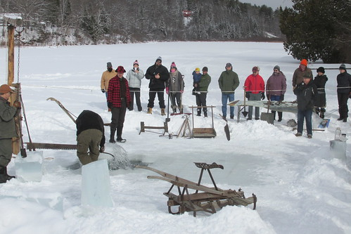 Pulling a block of ice out of the lake