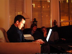peter on a laptop in the living room, with shelley a…