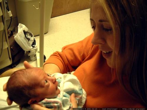 newborn flynn looking at his mom   dscf1872