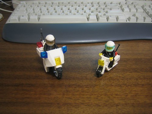 two generations of lego police motorbike