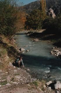Mum kneeling on the river bank
