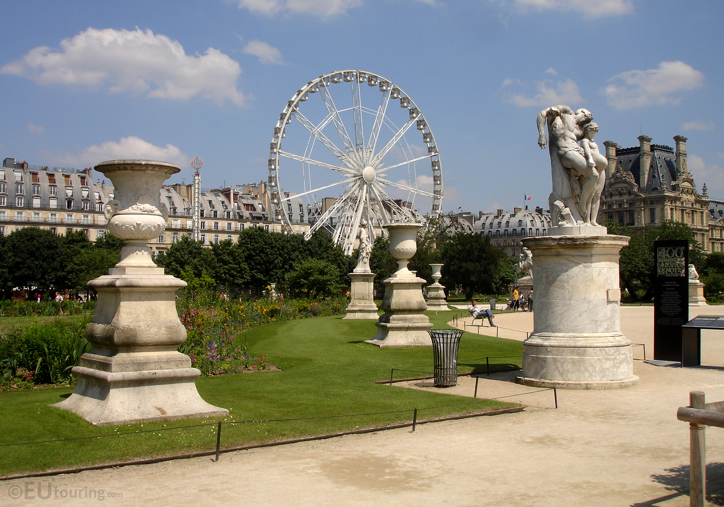Statues and ferris wheel