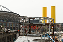 Yellow ventilation stacks rise near Seattle's stadiums