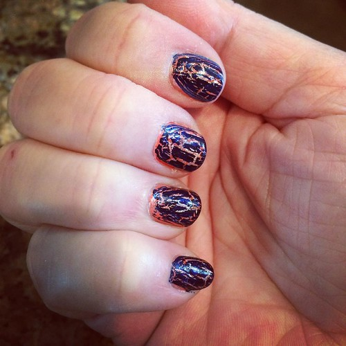 Today's nails. Coral base, silver crackle, top coat then navy shattered. Sort of liking it.