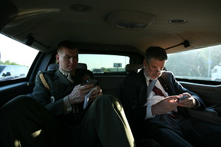 David Addington and Military Aide Tim Stefanick Type on Their BlackBerries While in Limousine in Kiev, Ukraine