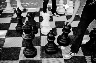 Tiny people on a chessboard