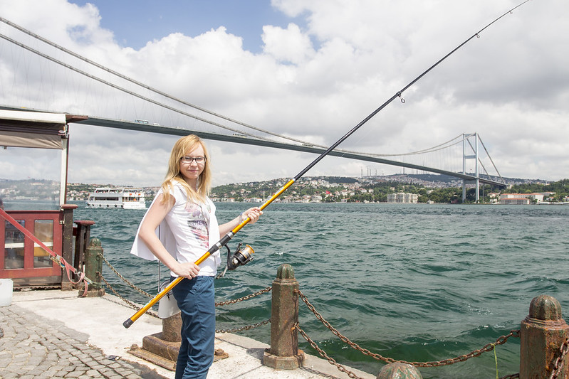 Paulina fishing in the Bosphorus, Ortakoy, Istanbul