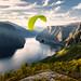 Paraglider flying over Aurlandfjord, Norway by framedbythomas