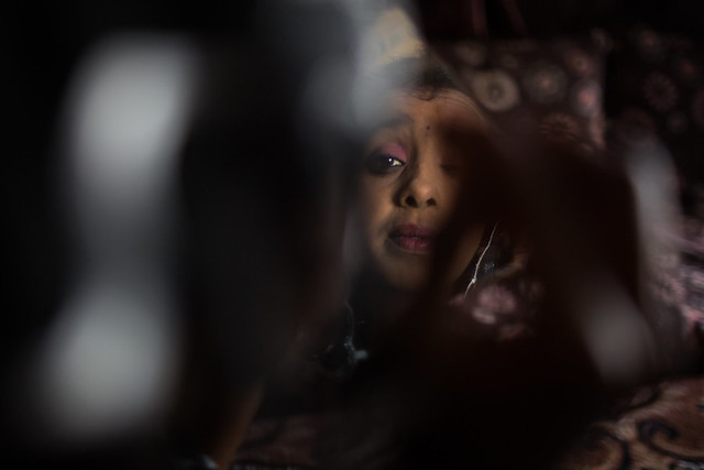 Ubah Jemal, 15, applies makeup before a meeting of the Girls Club in Jigjiga