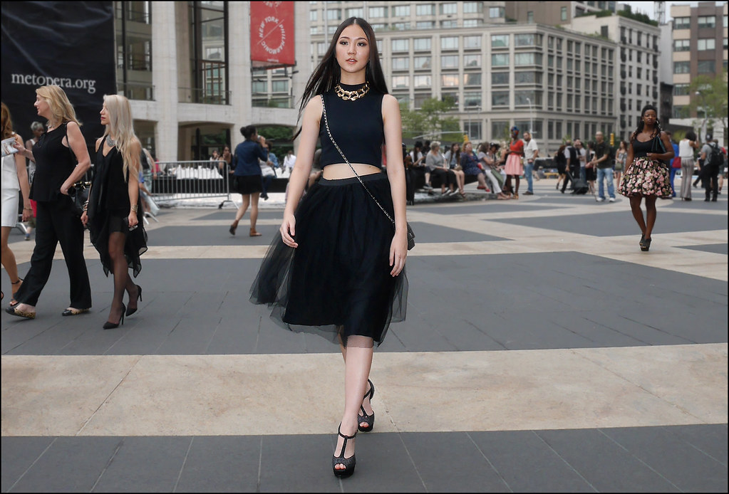 SS7-15 9w black sleeveless high neck crop top knee lenght black seethru over black skirt statement gold chain necklace