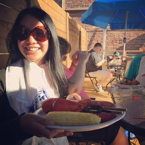 Mei holding her lobster dinner.