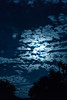 Blue Moon Behind Clouds 1