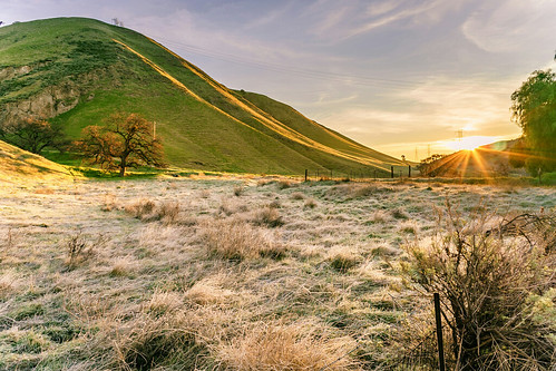 outdoor nature landscape sunrise sky clouds mountains hills grass green frost tree rural countryside