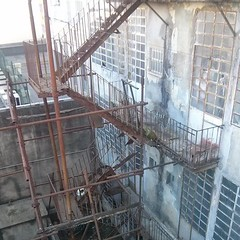 outdoor structure(0.0), reinforced concrete(0.0), cage(0.0), animal shelter(0.0), iron(1.0), scaffolding(1.0),