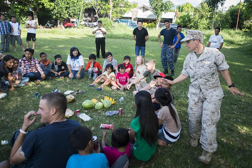 MANADO, Indonesia - Sailors and Marines from the Whidbey Island-class amphibious dock landing ship USS Rushmore (LSD 47) and the embarked 15th Marine Expeditionary Unit (MEU) play duck, duck, goose with children and staff from the Panti Bakti Mulia orphanage.