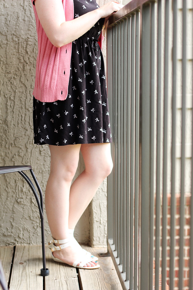 White Boohoo Sandals, Bow Print Dress, and Pink Short Sleeved Cardigan