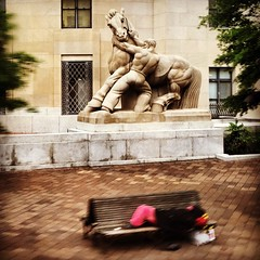 This sculpture is called 'Man Controlling Trade' and it sits outside the Federal Trade Commission in Washington DC. I snapped it while we were driving by as the (seemingly) homeless person sleeping on the bench was an interesting juxtaposition.