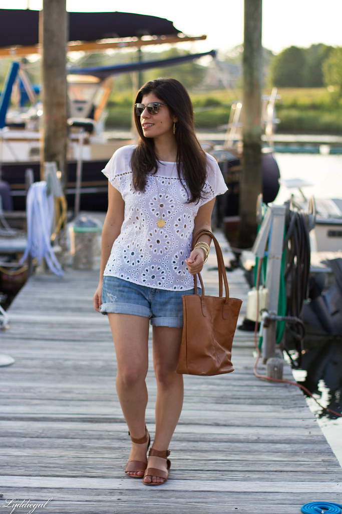 eyelet lace top, denim shorts, brown leather tote.jpg