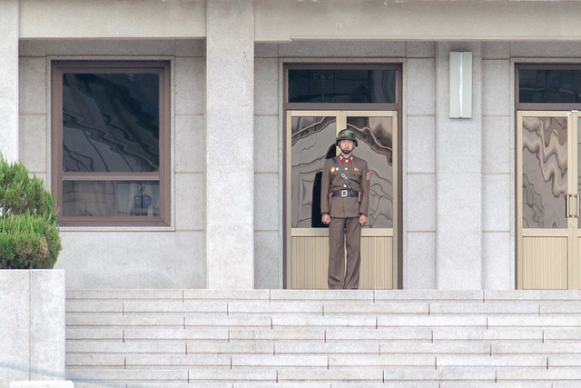 North Korean army on guard and a spy (to the left window).