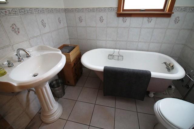 Guest bath with claw foot tub;