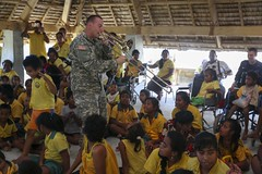 Sgt. 1st Class Chris Martin plays trombone during a concert at the School and Center for Children with Disabilities.(U.S. Marine Corps/Sgt. James Gulliver)