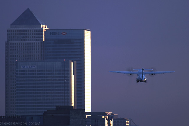 EuroWings ATR 72 200 taking off at London City Airport with Canary Wharf in the background